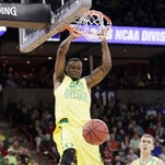 Oregon forward Elgin Cook (23) dunks during the second half of a first-round men's college basketball game in the NCAA Tournament against Holy Cross in Spokane, Wash., Friday, March 18, 2016. (AP Photo/Young Kwak)