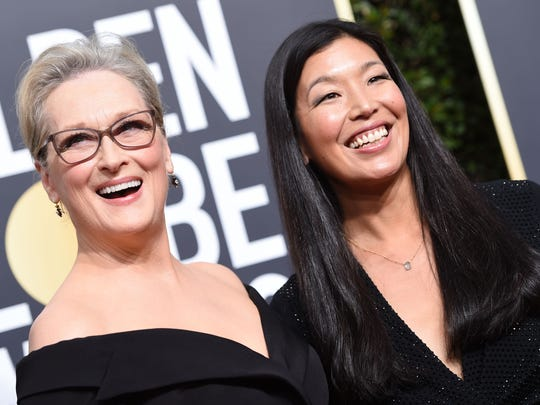 Meryl Streep and Ai-jen Poo, head of the National Domestic Workers Alliance, arrive at the Golden Globe Awards in Beverly Hills.