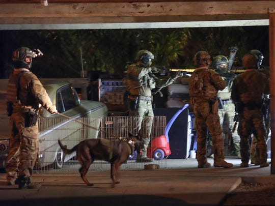 Authorities conduct a pre-dawn raid on a home on Rosa Parks Road in Palm Springs, December 20, 2017.