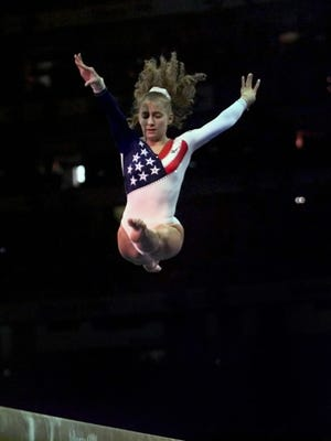 Shannon Miller performs a balance beam routine at a Summer Olympics gymnastics gala, Atlanta, July 30, 1996.