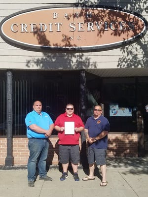 Dan Chapman, owner of Bath Credit Services, recently presented a check of $500 to the Bath Volunteer Fire Department. Pictured, from left: Chief Matt Glashauser, Chapman and President Jason Causer.