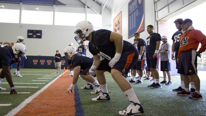 Auburn offensive tackle Robert Leff participates with others in a drill during a 2015 football practice.