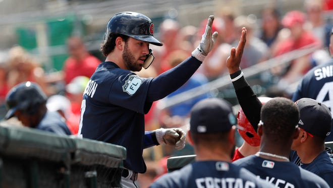 Atlanta Braves' Dansby Swanson (7) is greeted at the dugout by teammates after hitting a home run in the first inning of a spring training baseball game against the St. Louis Cardinals, Thursday, March 2, 2017, in Jupiter, Fla.