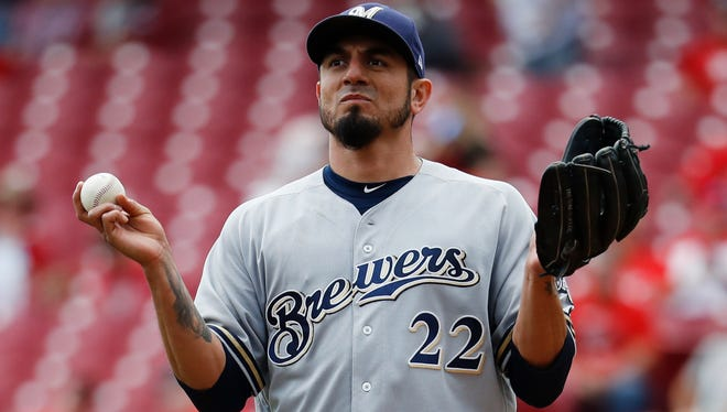 Brewers starting pitcher Matt Garza reacts after walking the Reds' Scott Schebler and forcing in a run in the third inning Wednesday.