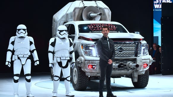 Jeremy Tucker, a Nissan vice president,, stands beside