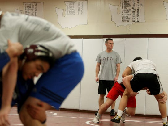 South Kitsap wrestling coach Chad Nass looks on as