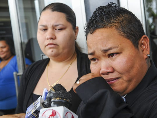 In this June 5 file photo, Loretta Pangelinan, right, wipes tears of joy from her eyes as she and her partner, Kathleen Aguero, speak to reporters on the steps of the U.S. District Court of Guam building in Anigua . The couple filed a lawsuit in April after they were denied the application for a marriage license at the Department of Public Health and Social Services, but on June 5, the couple won a ruling handed down by a federal judge, that declares a Guam law, that defines marriage as a union between couples of the opposite sex, to be unconstitutional. The U.S. Supreme Court later struck down all laws that ban same-sex unions. Guam lawmakers on Wednesday voted to pass a bill that puts Guam law in line with the court rulings. Rick Cruz/Pacific Daily News/rmcruz@guampdn.com