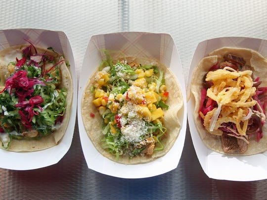 From left, Buffalo shrimp taco, sliced adobo chicken taco, and smoked brisket taco at the Taco Dive Bar in Peekskill.