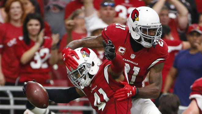 Arizona Cardinals defensive back Marcus Cooper (41) celebrates his interception for a touchdown with cornerback Patrick Peterson (21) against the Tampa Bay Buccaneers during the third quarter at University of Phoenix Stadium in Glendale on Sept. 18, 2016.