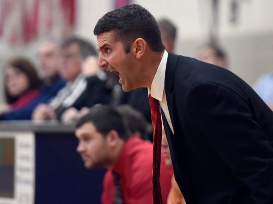 Mater Dei head coach Kurt Wildeman shouts out defensive instructions as they go up against Reitz during the first quarter of the game at Reitz in Evansville Friday.