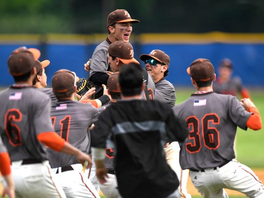 Pascack Hills pitcher Brandon Siegenthaler (center, top) celebrates with teammates. Pascack Hills defeated Don Bosco 3-1 in the Bergen County baseball tournament championship in Demarest, NJ on Monday, May 28, 2018.
