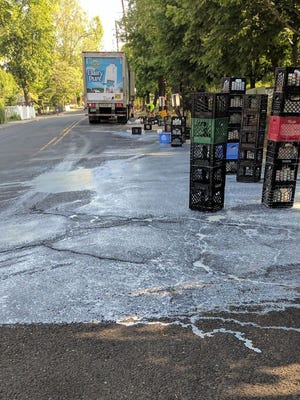 A refrigerated truck heading to a supermarket spilled 160 gallons of milk across South Front Street early Wednesday morning.