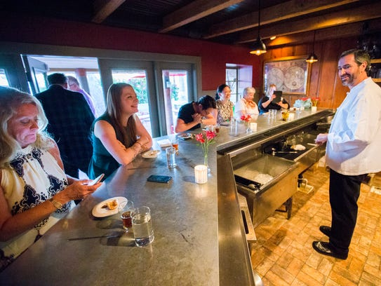 Chef Kevin Binkley talks with guests at Binkley's Restaurant