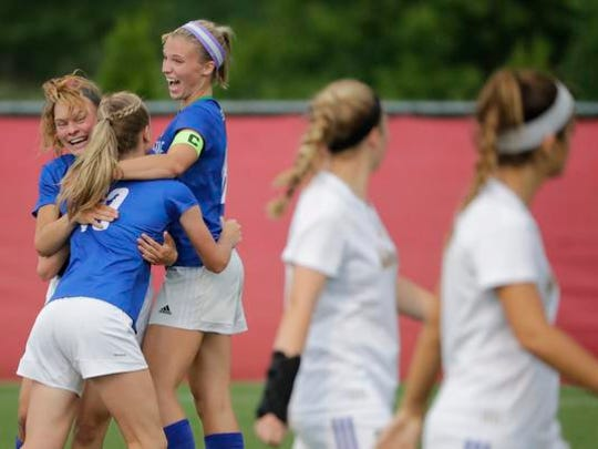 Green Bay Notre Dame High School's Jenna Cuene, center, celebrates scoring a goal with teammates Izzy Kellner, left, and Laken Anderson, right, against Catholic Memorial High School during their WIAA Division 3 final girls state soccer game Saturday, June 16, 2018, at Uihlein Soccer Park in Milwaukee, Wis.