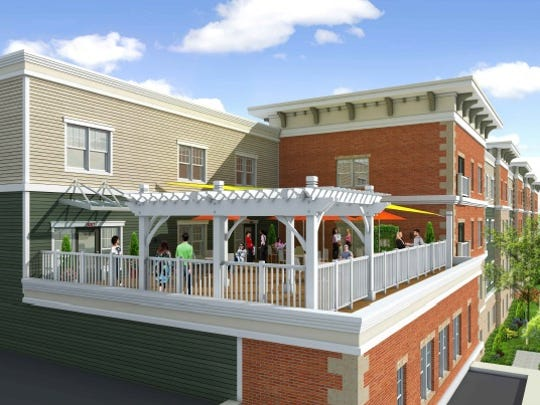 A rendering of the upper patio of one of the buildings in the proposed Eastman Reserve along Woodside Street in northwest Rochester.