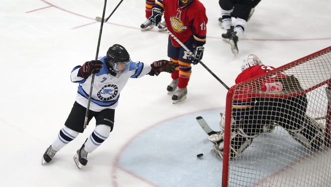Suffern's Ted Bristol (7) reacts to the go-ahead goal during a varsity ice hockey game against Pelham at Sport -O-Rama in Monsey on Saturday, Nov. 28, 2015.