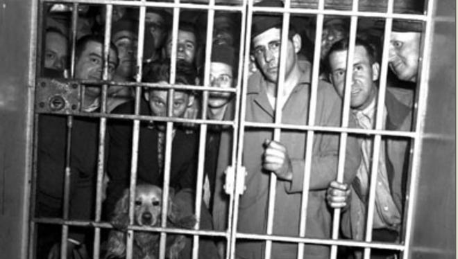 A dog was swept up among those jailed on charges of disorderly conduct during the protests after more than 400 city workers were fired for trying to unionize in May of 1946.