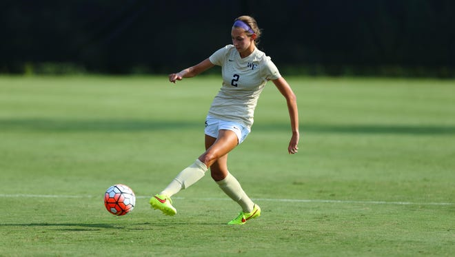Madison Baumgardner, a 2015 Colerain High School grad, plays a ball in Wake Forest's season opener Aug. 23, a 4-0 win over Georgia.