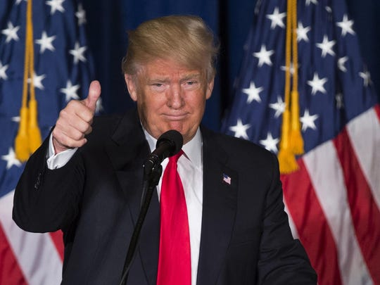 Republican presidential candidate Donald Trump gives a thumbs up after giving a foreign policy speech Wednesday at the Mayflower Hotel in Washington.