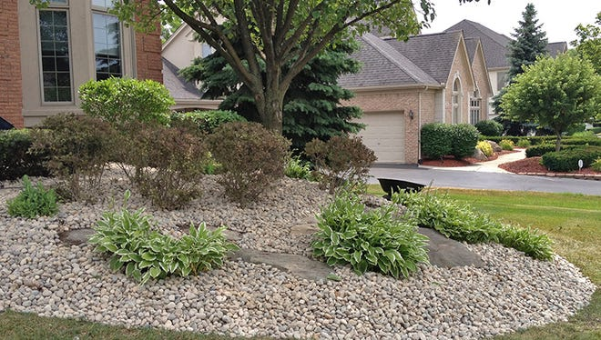 Mulching your landscape with stone can reduce weeding for a few years. Then what?