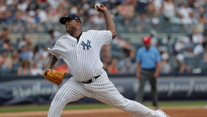 New York Yankees starting pitcher CC Sabathia delivers against the Atlanta Braves during the third inning of a baseball game, Wednesday, July 4, 2018, in New York.
