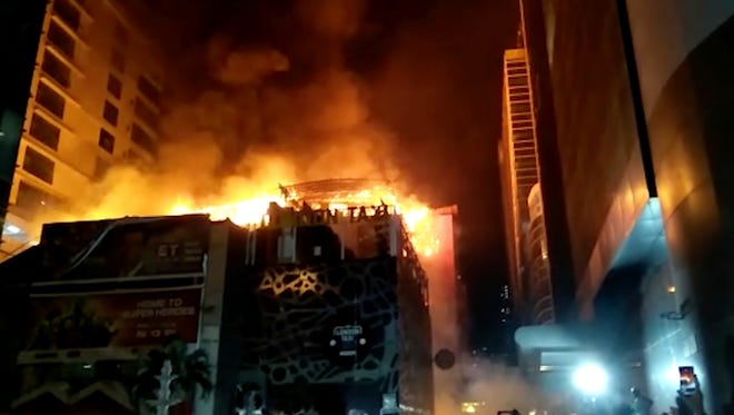 In this image made from video, a building is on fire in Mumbai, India, early Friday, Dec. 29, 2017.