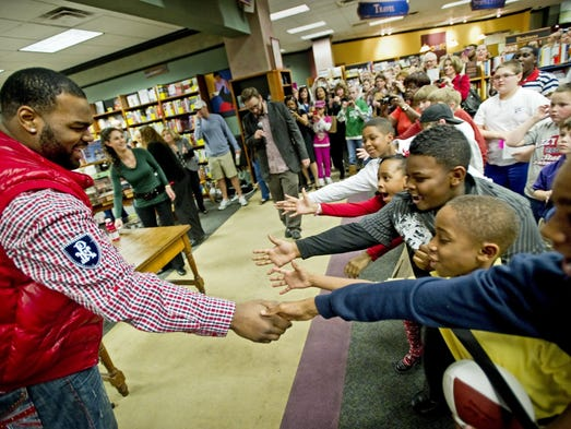 February 16, 2011 - Michael Oher shakes hands with