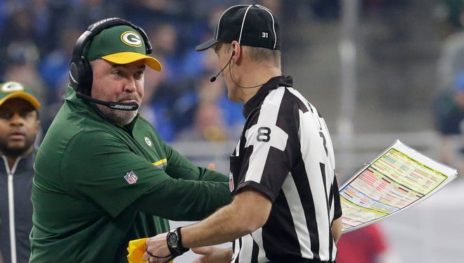 Green Bay Packers head coach Mike McCarthy questions  a penalty during the third quarter.