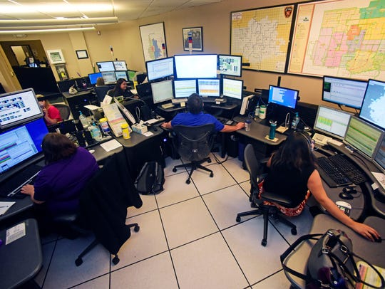 Dispatchers monitor calls from their work station at