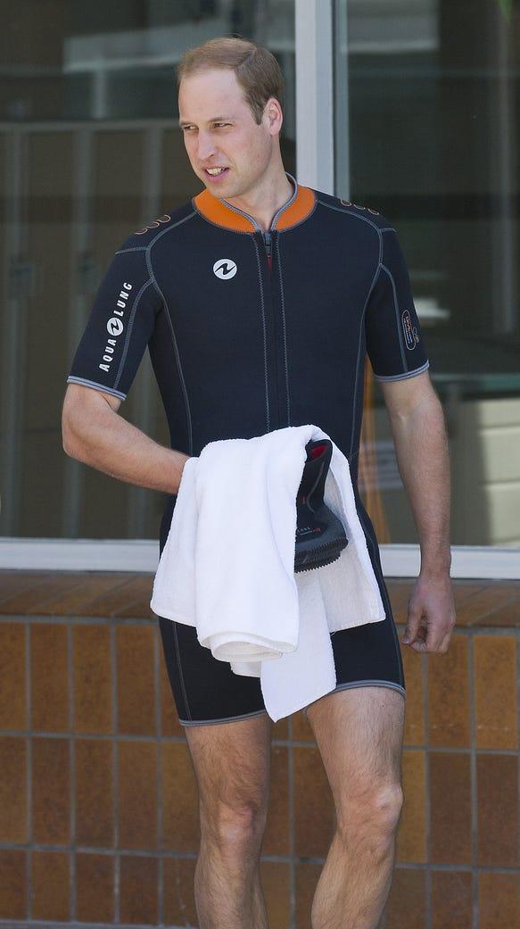 Nice legs! Prince William prepares to snorkel and scuba