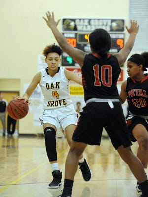 Oak Grove senior Derricka Millinghaus takes possession of the ball in a game against Petal High School on Friday in Hattiesburg.