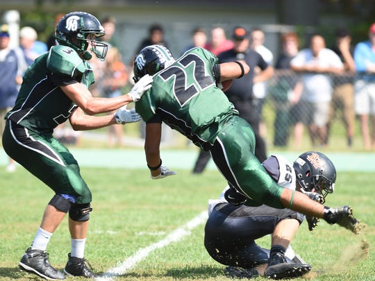 Spackenkill running back Andres Blanco is tackled during a game against Marlboro on Sept. 19, 2015.