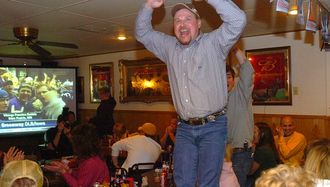Vikings fan Doug Nelson jumps up on his chair after Mount Vernon's Chad Greenway was drafted 17th overall by the Minnesota Vikings.