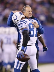 Indianapolis Colts head coach Chuck Pagano huged Reggie Wayne after Wayne's third quarter touchdown in a game against the New York Giants on Nov. 3.