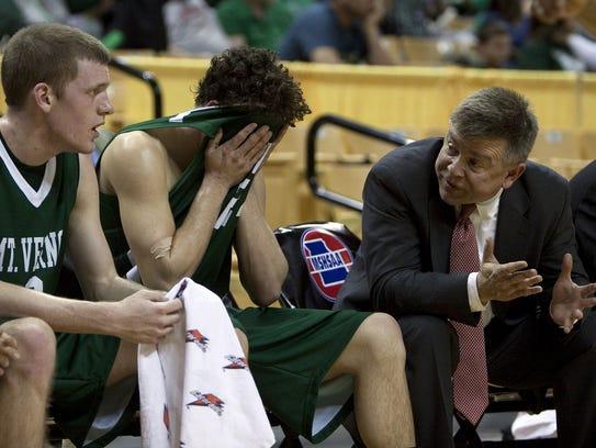 Skip Brock, right, spent 19 seasons coaching boys basketball