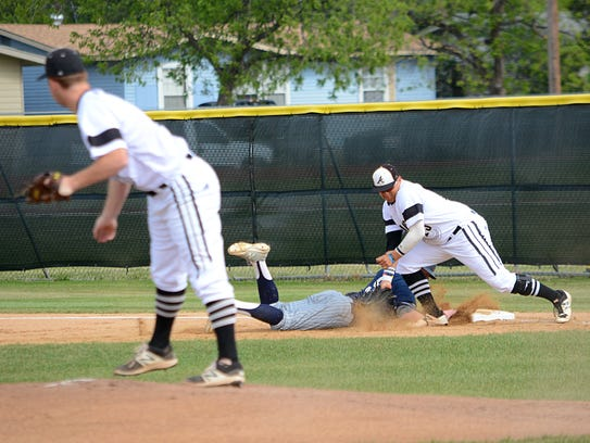 Abilene High first baseman digs out a pickoff throw