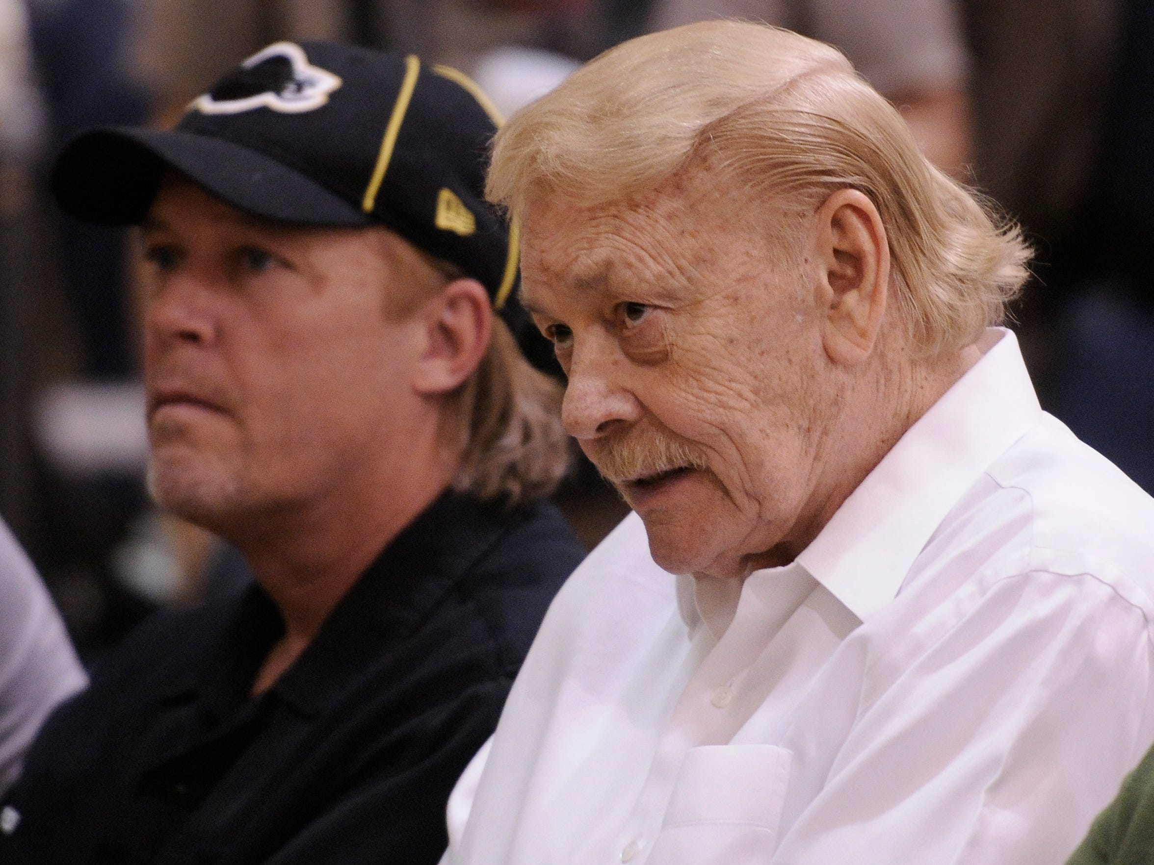 'It's almost like they want him to be a reincarnation of his dad, but he can't.' Former Lakers great Jerry West says about Jim Buss, left, and his father, Jerry.