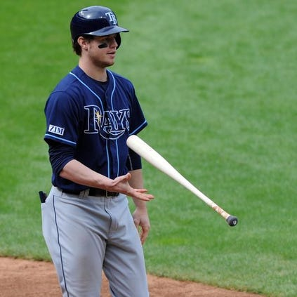 Tampa Bay right fielder Wil Myers tosses his bat after striking out against the Cleveland Indians.