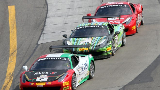Drivers compete in the Ferrari Challenge North America race at Watkins Glen International in 2014.
