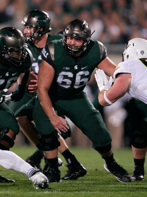 Michigan State's Jack Allen (66) blocks during an NCAA college football game against Oregon, Saturday, Sept. 12, 2015, in East Lansing, Mich. Michigan State won 31-28. (AP Photo/Al Goldis)