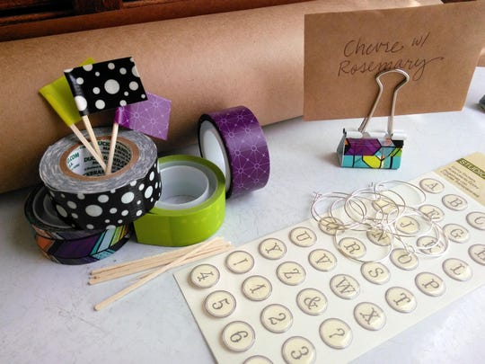 Make mini flags, charms and stands out of washi tape, toothpicks, binder clips, brown paper, wire hoops and epoxy alphabet stickers.
