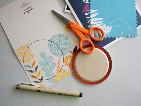 Give second life to old notecards by re-purposing them into paper coasters.