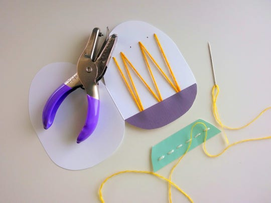 Create your own Easter egg card with just a bit of colorful paper, string, needle, small hole punch and glue.