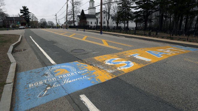 Tthe Boston Marathon start line in Hopkinton, Mass., was vacant on the scheduled day of the 124th race, due to the COVID-19 virus outbreak. Organizers have postponed the 2021 race at least until next fall.
