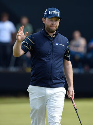 Branden Grace reacts after making a birdie putt on the 14th green during the third round of The 146th Open Championship.