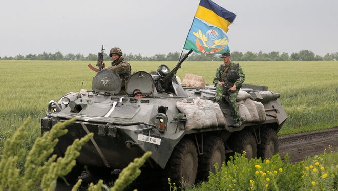 Ukrainian army paratroopers move to position in Slovyansk, Ukraine, Saturday, May 31, 2014.The Ukrainian Acting Defence Minister said on Friday that troops had ousted separatists from southern and western parts of the Donetsk region and north of the Luhansk region.