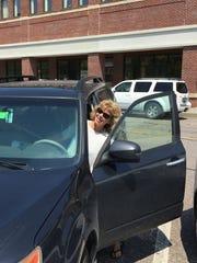 Tamara Smith of Bakersfield returns to her car Thursday