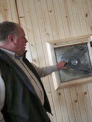 John Stierhoff talks about the old safe they kept for use at the newly remodeled Rex Landscaping company headquarters.