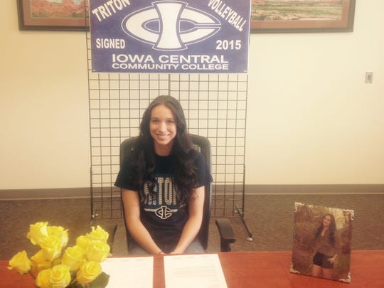 Cedar's Shae Johnson, a 5-foot-10 outside hitter, signed her National Letter of Intent to play volleyball for Iowa Central Community College on Wednesday.