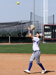 Bloomfield's Katie Nelson catches a pop fly during
